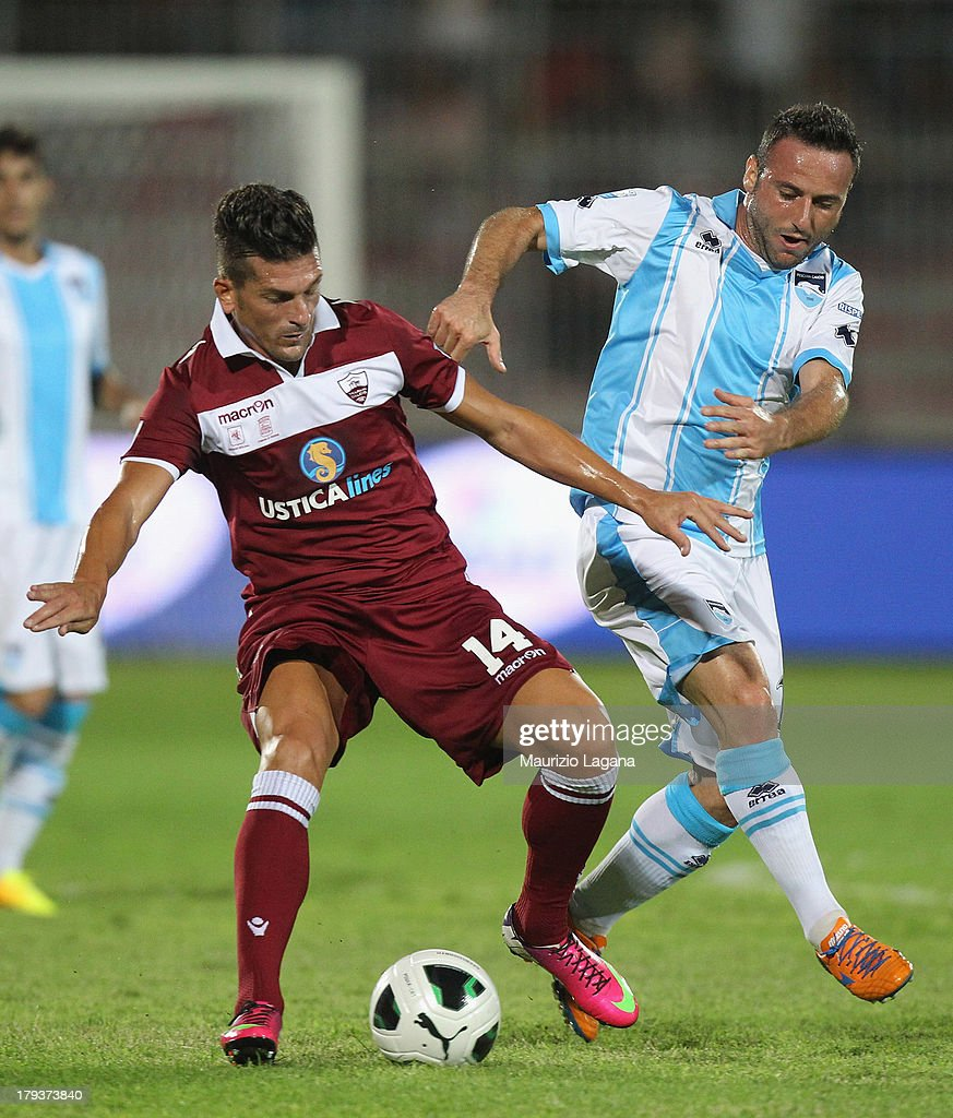 Maurizio Ciaramitaro (L) of Trapani competes for the ball with Aniello Cutolo of Pescara during the Serie B match between Trapani Calcio and Pescara Calcio at Stadio Provinciale on September 2, 2013 in Trapani, Italy.