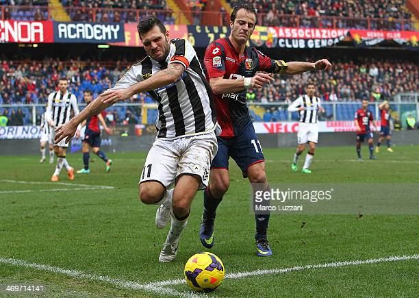 Maurizio Domizzi of Udinese Calcio competes for the ball with Alberto Gilardino of Genoa CFC during the Serie A match between Genoa CFC and Udinese...