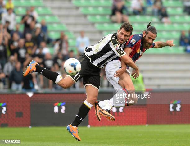 Maurizio Domizzi of Udinese Calcio competes with Davide Moscardelli Bologna FC during the Serie A match between Udinese Calcio and Bologna FC at...