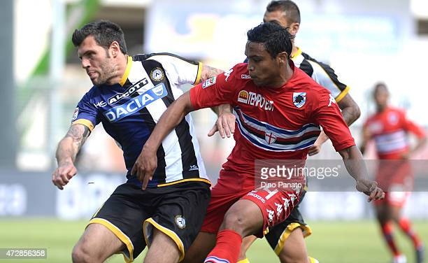 Maurizio Domizzi of Udinese Calcio competes with Luis Fernando Muriel of UC Sampdoria during the Serie A match between Udinese Calcio and UC...