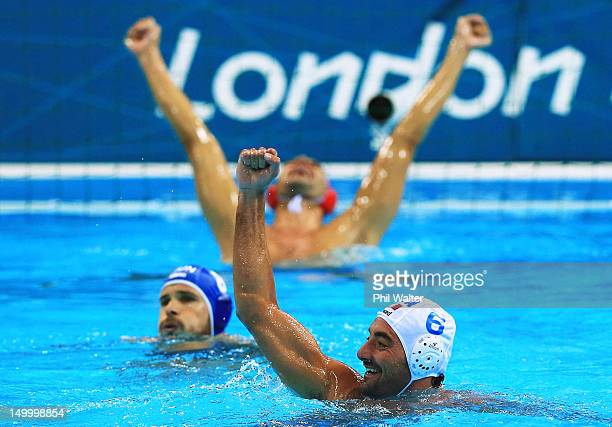 Maurizio Felugo of Italy celebrates winning the Men's Water Polo Quarterfinal match between Italy and Hungary on Day 12 of the London 2012 Olympic...