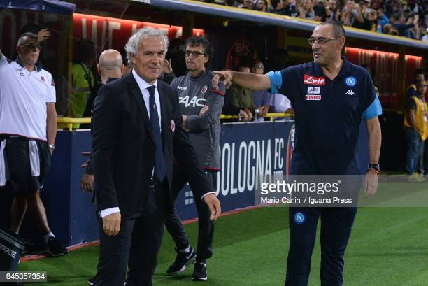 Maurizio Sarri head coach of SSC Napoli talks to Roberto Donadoni head coach of Bologna FC before the beginning of the Serie A match between Bolgna...
