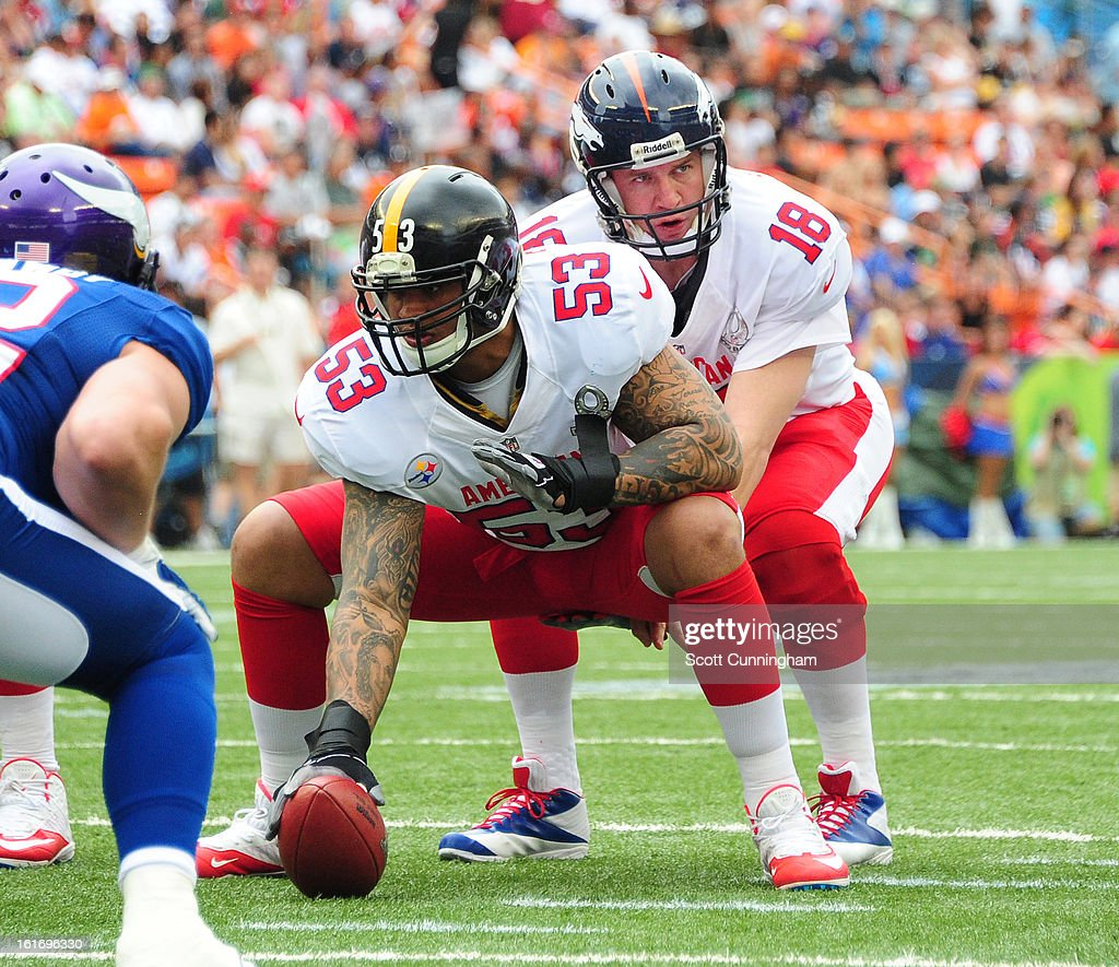 Maurkice Pouncey #53 of the Pittsburgh Steelers and the AFC centers the ball to Peyton Manning against the National Football Conference team during the 2013 Pro Bowl at Aloha Stadium on January 27, 2013 in Honolulu, Hawaii