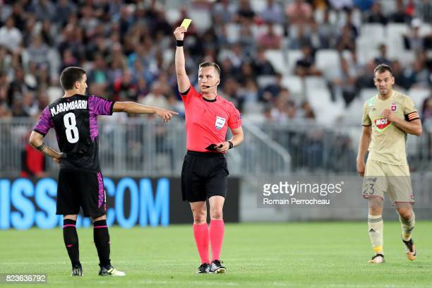 Mauro Arambarri of Bordeaux is shown a yellow card during the UEFA Europa League qualifying match between Bordeaux and Videoton at Stade Matmut...