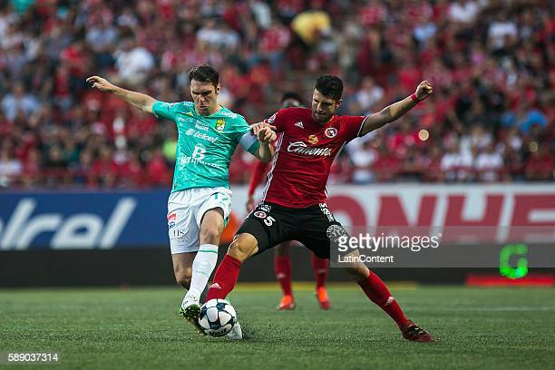 Mauro Boselli of Leon fights for the ball with Guido Rodriguez of Tijuana during the 5th round match between Tijuana and Leon as part of the Torneo...
