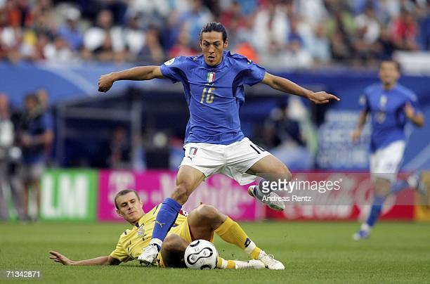 Mauro Camoranesi of Italy hurdles the challenge from Andriy Nesmachnyi of the Ukraine during the FIFA World Cup Germany 2006 Quarterfinal match...