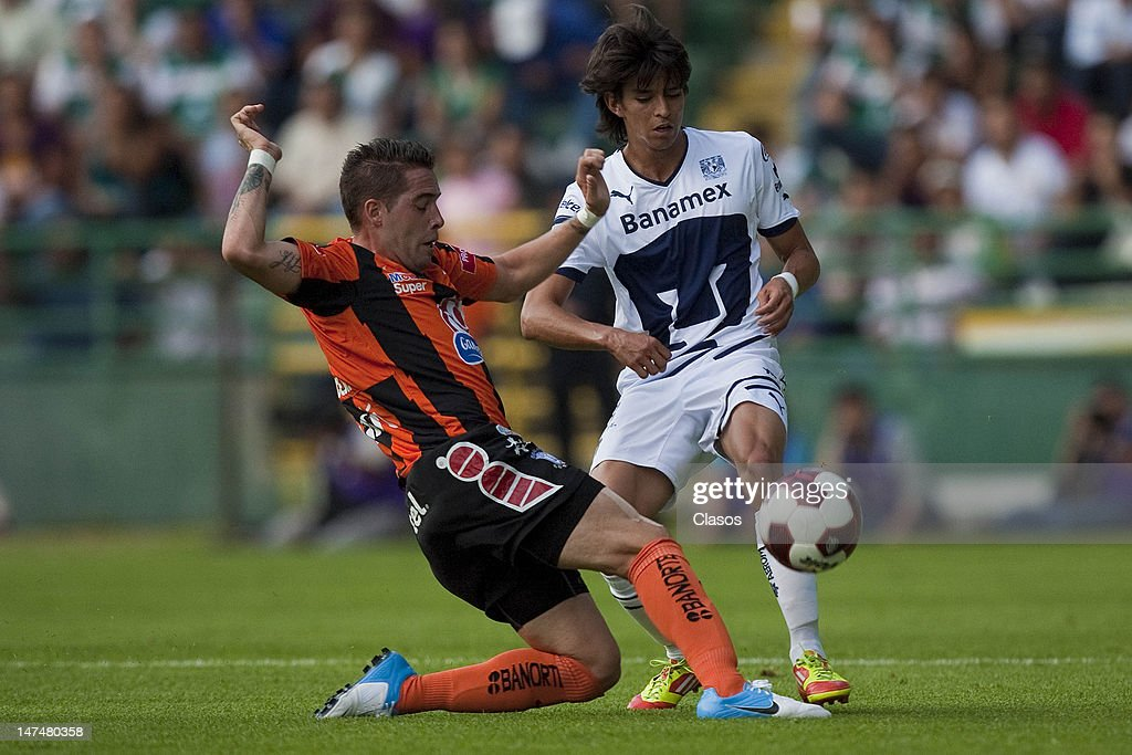 Mauro Cejas (L) of Pachuca struggles for the ball with Carlos Orrantia of Pumas, during a match between Pachuca and Pumas as part of the Banorte Cup at the Nou Camp Stadium on June 28, 2012 in Guanajuato, Mexico.