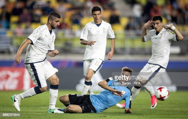 Mauro Coppolaro of Italy challenges Rodrigo Bentancur of Uruguay during the FIFA U20 World Cup Korea Republic 2017 group D match between Italy and...