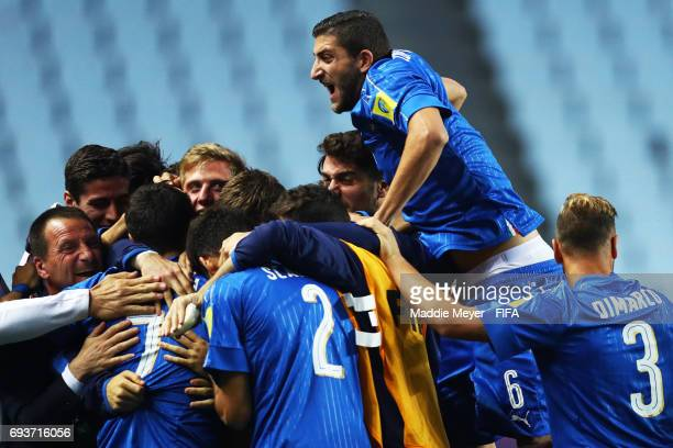 Mauro Coppolaro of Italy jumps on top of his teammates as they celebrate a goal scored by Riccardo Orsolini during the FIFA U20 World Cup Korea...