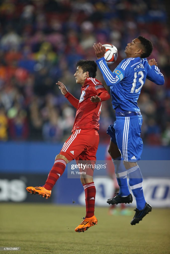 Mauro Diaz of FC Dallas and Matteo Ferrari of Montreal Impact jump for the header at Toyota Stadium on March 8 2014 in Frisco Texas