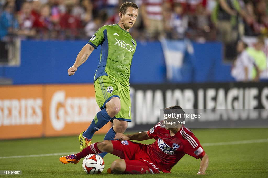 Mauro Diaz #10 of the FC Dallas steals the ball from Chad Barrett #19 of the Seattle Sounders FC on April 12, 2014 at Toyota Stadium in Frisco, Texas.