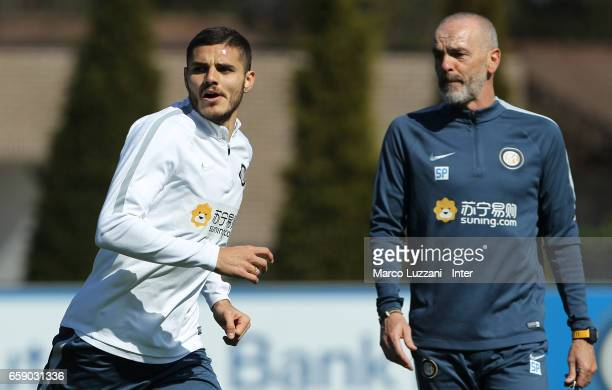 Mauro Emanuel Icardi and FC Internazionale Milano coach Stefano Pioli look on during the FC Internazionale training session at the club's training...