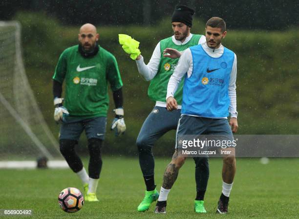 Mauro Emanuel Icardi cis challenged by Davide Santon during the FC Internazionale training session at the club's training ground Suning Training...