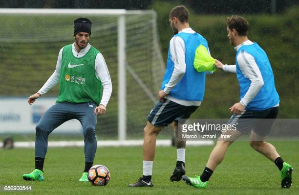Mauro Emanuel Icardi competes with Davide Santon and Cristian Ansaldi of FC Internazionale looks on during the FC Internazionale training session at...