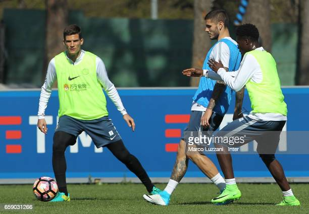 Mauro Emanuel Icardi is challenged by Eloge Koffi Yao Guy during the FC Internazionale training session at the club's training ground Suning Training...