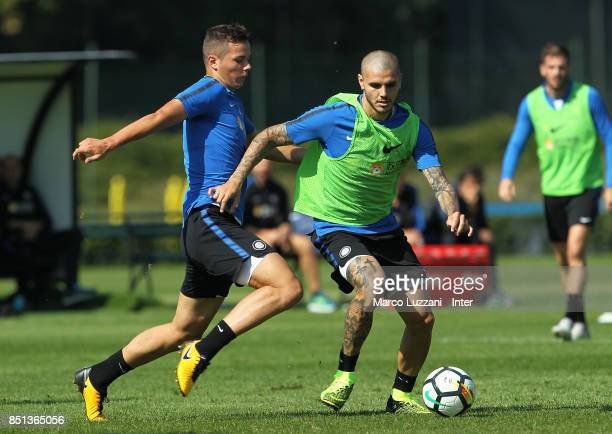 Mauro Emanuel Icardi is challenged by Zinho Vanheusden during the FC Internazionale training session at the club's training ground Suning Training...