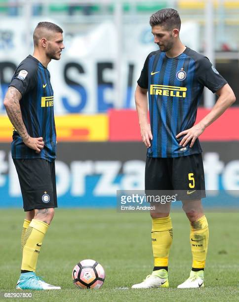 Mauro Emanuel Icardi of FC Internazionale Milano and his teammate Roberto Gagliardini show their dejection during the Serie A match between FC...