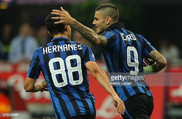 Mauro Emanuel Icardi of FC Internazionale Milano celebrates his second goal with his teammate Anderson Hernanes during the Serie A match between FC...