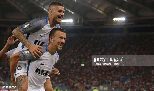 Mauro Emanuel Icardi of FC Internazionale Milano celebrates his second goal with his teammate Ivan Perisic during the Serie A match between AS Roma...