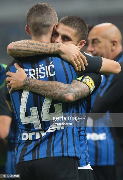 Mauro Emanuel Icardi of FC Internazionale Milano celebrates his second goal with his teammate Ivan Perisic during the Serie A match between FC...