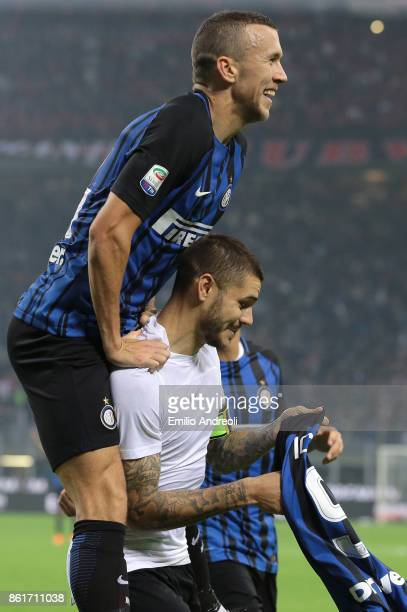 Mauro Emanuel Icardi of FC Internazionale Milano celebrates his third goal with his teammate Ivan Perisic during the Serie A match between FC...