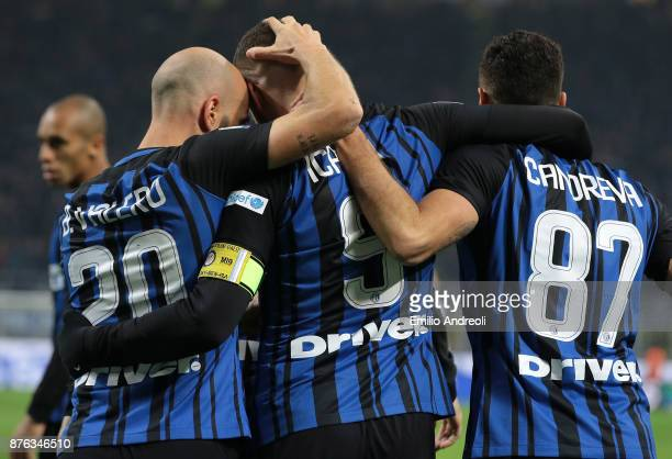 Mauro Emanuel Icardi of FC Internazionale Milano celebrates with his teammate Iglesias Borja Valero and Antonio Candreva after scoring the opening...