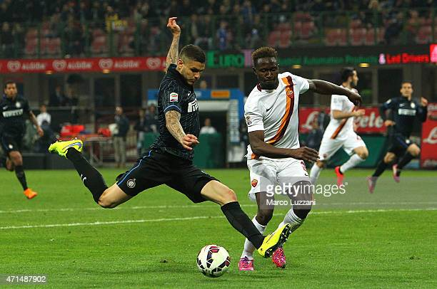 Mauro Emanuel Icardi of FC Internazionale Milano competes for the ball with Mapou YangaMbiwa of AS Roma during the Serie A match between FC...