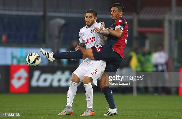 Mauro Emanuel Icardi of FC Internazionale Milano competes for the ball with Nicolas Andres Burdisso of Genoa CFC during the Serie A match between...