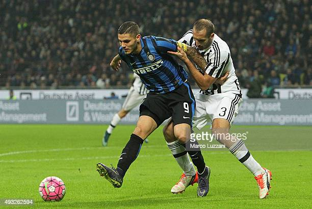 Mauro Emanuel Icardi of FC Internazionale Milano competes for the ball with Giorgio Chiellini of Juventus FC during the Serie A match between FC...