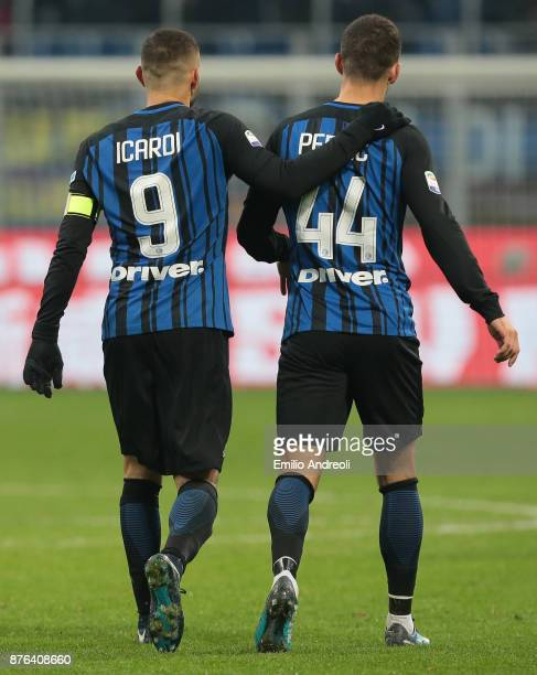 Mauro Emanuel Icardi of FC Internazionale Milano embraces his teammate Ivan Perisic during the Serie A match between FC Internazionale and Atalanta...