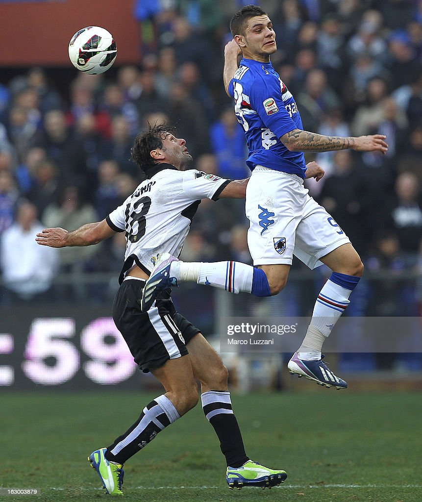 Mauro Emanuel Icardi (R) of UC Sampdoria competes for the ball with <a gi-track='captionPersonalityLinkClicked' href=/galleries/search?phrase=Marco+Parolo&family=editorial&specificpeople=6474753 ng-click='$event.stopPropagation()'>Marco Parolo</a> (L) and Massimo Gobbi (C) of Parma FC during the Serie A match between UC Sampdoria and Parma FC at Stadio Luigi Ferraris on March 3, 2013 in Genoa, Italy.