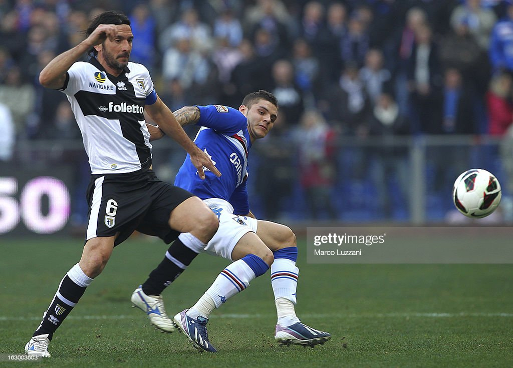Mauro Emanuel Icardi (R) of UC Sampdoria competes for the ball with Alessandro Lucarelli (L) of Parma FC during the Serie A match between UC Sampdoria and Parma FC at Stadio Luigi Ferraris on March 3, 2013 in Genoa, Italy.