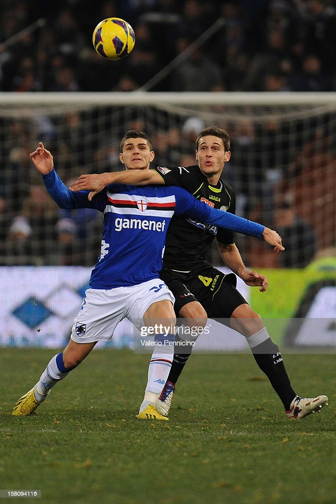 Mauro Emanuel Icardi (L) of UC Sampdoria competes with Gabriele Angella of Udinese Calcio during the Serie A match between UC Sampdoria and Udinese Calcio at Stadio Luigi Ferraris on December 10, 2012 in Genoa, Italy.