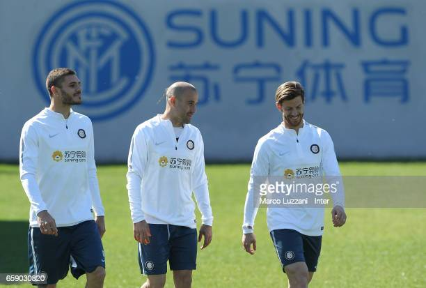 Mauro Emanuel Icardi Rodrigo Palacio and Cristian Ansaldi of FC Internazionale look on during the FC Internazionale training session at the club's...