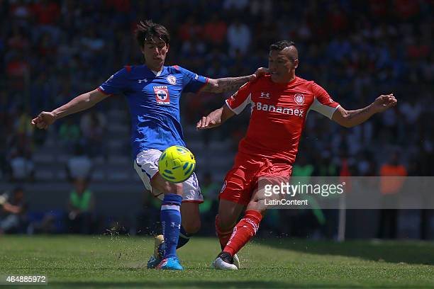 Mauro Formica of Cruz Azul struggles for the ball with Richard Ortiz of Toluca during a match between Toluca and Cruz Azul as part of 8th round...