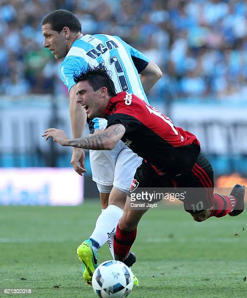 Mauro Formica of Newell's Old Boys and Luciano Aued of Racing Club battle for the ball during a match between Racing Club and Newell's Old Boys as...