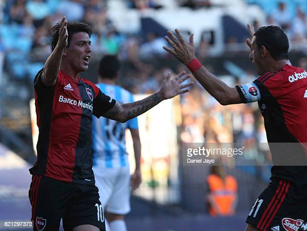 Mauro Formica of Newell's Old Boys celebrates with teammate Maxi Rodriguez of Newell's Old Boys after scoring during a match between Racing Club and...