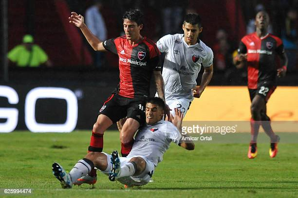 Mauro Formica of Newell´s Old Boys fight for the ball with Lucas Ceballos of Colon during a match between Colon and Newell's Old Boys as part of...