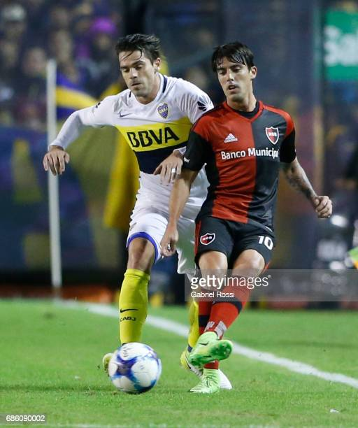 Mauro Formica of Newell's Old Boys fights for the ball with Fernando Gago of Boca Juniors during a match between Boca Juniors and Newell's Old Boys...