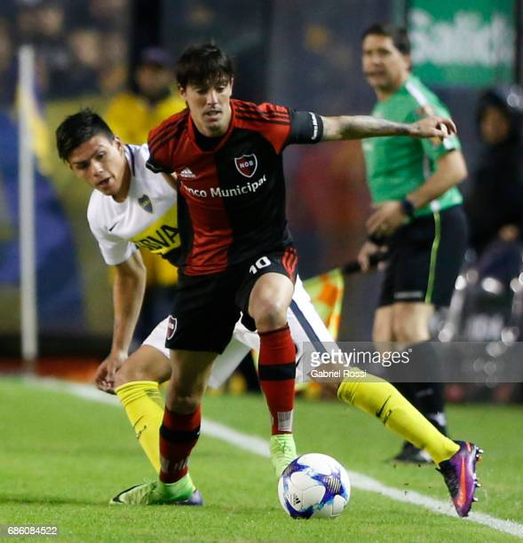 Mauro Formica of Newell's Old Boys fights for the ball with Jonathan Silva of Boca Juniors during a match between Boca Juniors and Newell's Old Boys...
