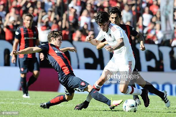 Mauro Formica of Newell's Old Boys fights for the ball with Marcos Senesi during a match between Newell's Old Boys and San Lorenzo as part of Torneo...