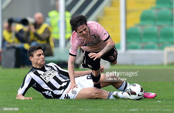 Mauro Formica of Palermo and Jorge Teixeira of Siena compete for the ball during the Serie A match between US Citta di Palermo and AC Siena at Stadio...
