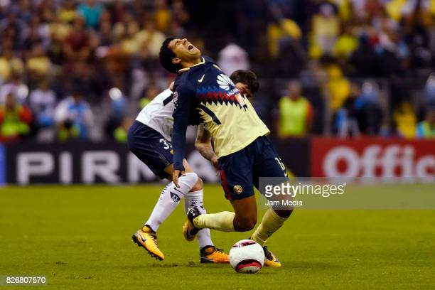 Mauro Formica of Pumas and Cecilio Dominguez of America fight for the ball during the 3rd round match between America and Pumas UNAM as part of the...