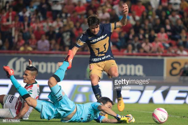 Mauro Formica of Pumas and Marcelo Barovero of Necaxa fight for the ball during the 13th round match between Necaxa and Pumas UNAM as part of the...