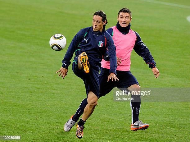 Mauro German Camoranesi and Salvatore Bocchetti of Italy compete for the ball during an Italian training session at the 2010 FIFA World Cup at Green...