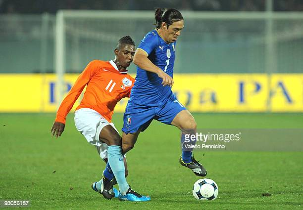 Mauro German Camoranesi of Italy is challenged by Eljero Elia of Holland during the international friendly match between Italy and Holland at...