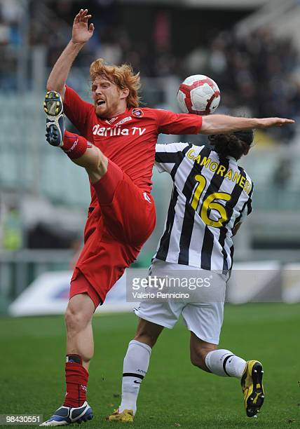 Mauro German Camoranesi of Juventus FC clashes with Davide Biondini of Cagliari Calcio during the Serie A match between Juventus FC and Cagliari...