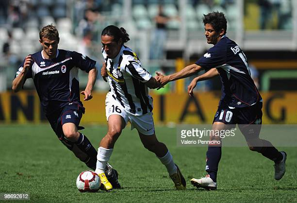 Mauro German Camoranesi of Juventus FC is challenged by Vladimir Koman and Paulo Vitor De Souza Barreto of AS Bari during the Serie A match between...
