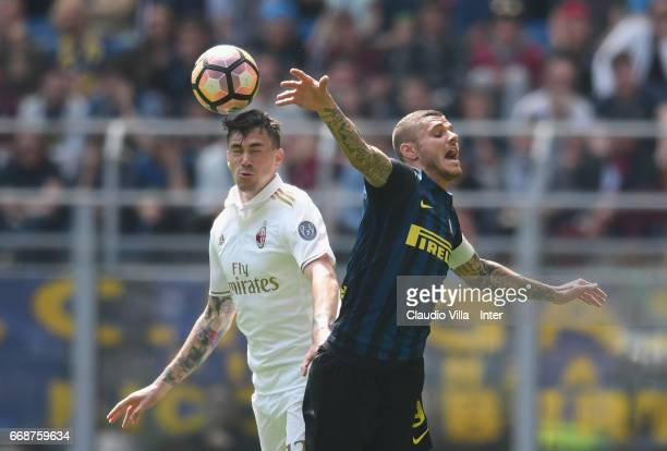 Mauro Icard of FC Internazionale competes for the ball with Alessio Romagnoli of AC Milan during the Serie A match between FC Internazionale and AC...