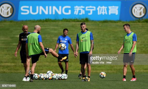 Mauro Icardi and Borja Valero of FC Internazionale in action during a training session at Suning Training Center at Appiano Gentile on August 3 2017...
